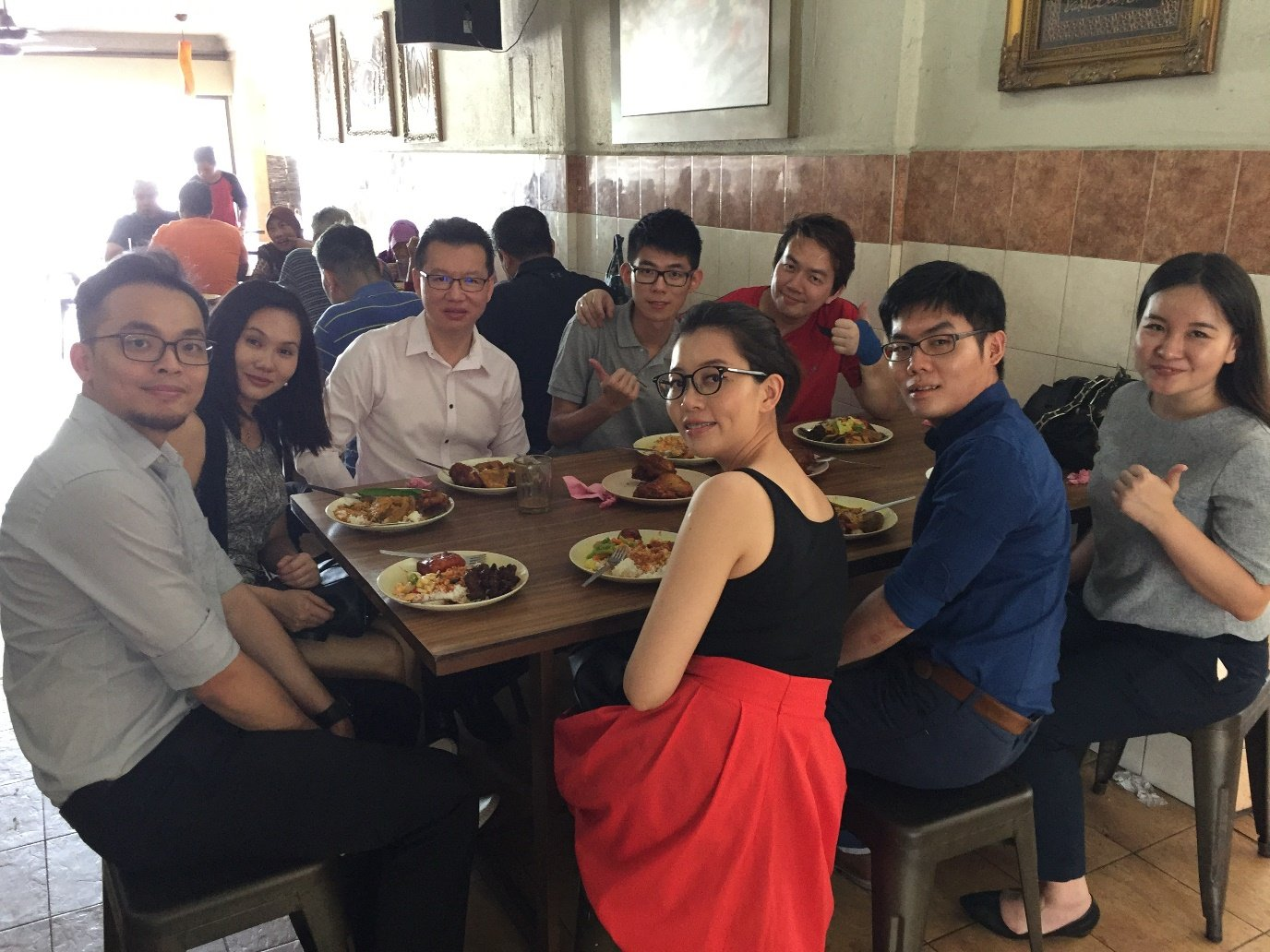 Isaac Wong having lunch with the doctors of Puretouch Clinic at Cargas, having Nasi Kandar